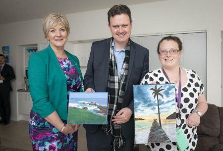 Transport Accident Commission client Claire Phillips with Minister for Finance Robin Scott and TAC Head of Independence Liz Cairns in Claire's new supported accommodation.